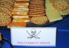 "Cheese and cracker tray labeled ""Polly's Parrot Treats"" as appetizer for a pirate theme party"