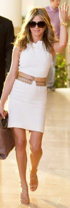 I love the dress with belt (and her purse).