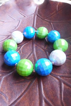 Rock your Seattle Sounders team spirit with this blue and green themed chunky bracelet!  It is made/sized for adults with durable, stretchy