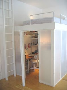 hidden office + bed.                          Another Pinner: Another idea for my guest room with Christmas storage under!