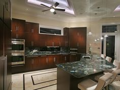 The look of natural stone is undoubtedly contemporary as well as sophisticated. So, it is a viable option when you decide to transform your outdated kitchen.  Labradorite Peacock Blue - Gem Surfaces