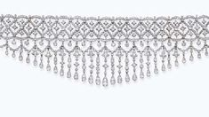 A FINE BELLE EPOQUE DIAMOND CHOKER NECKLACE, BY BOUCHERON. The circular and old-cut diamond fringe with floral motifs to the intricate diamond openwork choker necklace, circa 1905.