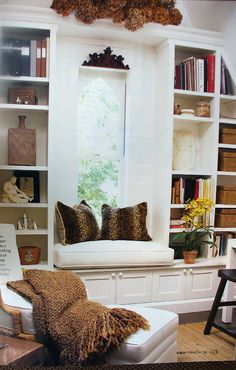 Great window seat and book shelves with storage under both