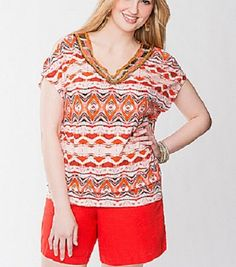 Sassy, cold shoulder tee shines up the tribal trend with a bead-embellished neckline. Banded bottom and notched neckline offers a flattering fit for any body type. Short sleeves. If you would like to see more pictures I am happy to email them to you. Please feel free to ask any questions. I will...