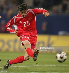 Hui Xie of China runs with the ball during the friendly game between Germany and China at the AOL Arena on October 12 2005 in Hamburg Germany
