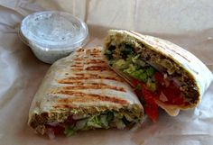 Vegan Shawarma:  Mediterranean chickpea shawarma, with a bean puree, vegan tzatziki, red onions, cucumbers, tomatoes, and shredded romaine...(vegan tortilla wrap available on request) at Mendocino Farms