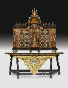 A Hispano-Flemish gilt-bronze-and gilt-metal-mounted ivory and tortoiseshell inlaid rosewood and ebonised parquetry and parcel-gilt cabinet on stand, the cabinet and the top of the base mid 17th century.