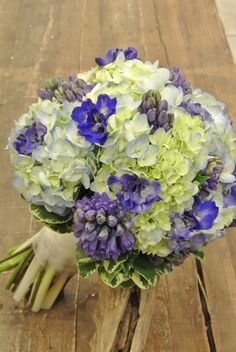 Blue and ivory bridal bouquet with blue hydrangea, hyacinth and delphinium. Designed by Forget-Me-Not Flowers in Banff.