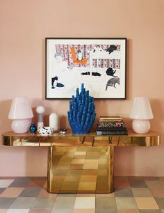 Gold, pink, and taupe entryway with cool metallic console!