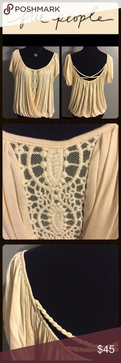 FREE PEOPLE - TOP FREE PEOPLE TOP - Very unique looking bone ivory color top.  The front is embroidered on top of a sheer mesh and the two free flowing pleats are gathered by the slightly elasticated bottom trim.  The low back has a double rope design. Beautiful top in excellent condition! Free People Tops