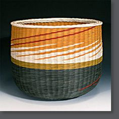 "Kari Lonning, ""Gold Band, Red Stripes"" hand dyed reed basket"