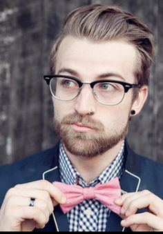 half rimmed glasses? check.  well groomed beard? check.  ironic pink bow tie? check. Gauged ears? Check. this is a dapper hipster!