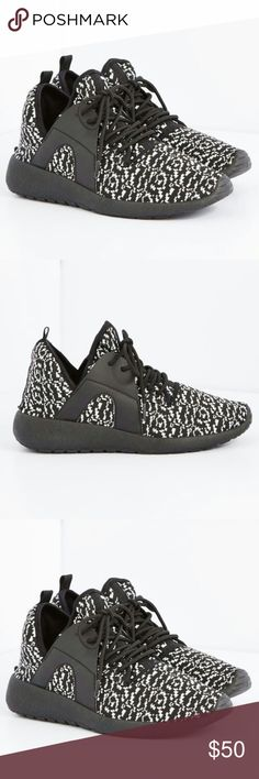 Black & White Speckled Low Top Sneaker Lace up and get going in style with the help of these trendy sneakers. They're designed with black and white speckled knit and faux leather sides at the upper. Complete with rubberized soles.  Lace-up Non-skid sole Man-made materials Imported Man made  Shoes Athletic Shoes