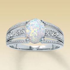 opal wedding band rings | Opal wedding ring. I'm kind of liking that it's unique. Not sure if I ...