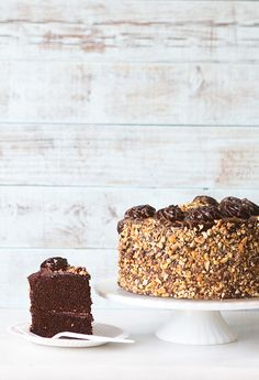 Treat yourself to this Kahlua Crunch Cake with a dark chocolate Kahlua buttercream. You won't regret it!