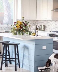white and blue kitchen - pretty!    The kitchen of @deborahstachelski is pure design inspiration. We especially love the horizontal blue clapboard on the island! #mypotterybarn #kitchengoals