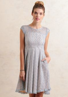 A must-have for the party circuits coming up, this light blue lace dress features a fit-and-flare silhouette with box pleats at the waist. Crafted with short sleeves and a knee-length hem for the...