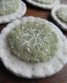 Creative Inspiration: Use leftover wool felted scraps to stitch up snowflakes.