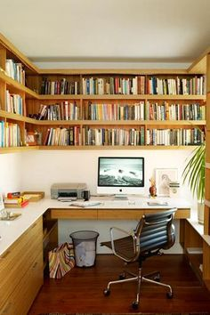How to Make a Small Room Look Bigger: 25 Tips That Work | Wooden wall bookshelves above a built-in desk
