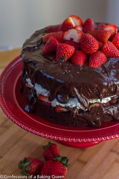 Now this is the Chocolate Cake for me!!Strawberries and Cream Chocolate Cake- www.confessionsofabakingqueen.com