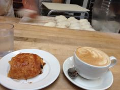 Chocolate croissant and a cappuccino at a French bakery