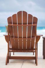 Wooden sun chair at luxury resort near caribbean sea stock photo