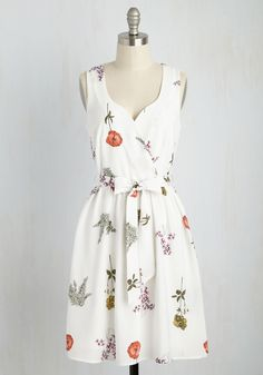Cute dress with colorful wildflowers and topped with a tied sash
