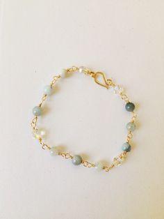 Aquamarine Bead Bracelet Light Blue Aquamarine Beaded Bracelet March Birthstone Bracelet Silver Wire Chain Bracelet (WC22) by JulemiJewelry on Etsy https://www.etsy.com/listing/218870230/aquamarine-bead-bracelet-light-blue
