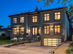 Night view of an American Masterpiece Marble Island, Island With Seating, Backyard, Patio, Large Bedroom, Window Wall, Large Homes, Property Listing, Calgary