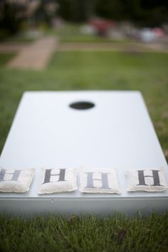 "Cute game idea with outdoor activities.  Corn hole with monogram bags!!  One team can be one initial (liiiike, ""S"") and the other side can be the other (""H"").  Can do letters in wedding colors!"