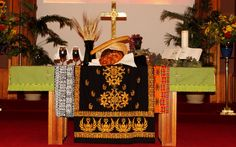 """The Body of Christ, broken for us. The Blood of Christ, poured out for us.""  World Communion Sunday 2015 at Morrisville United Methodist Church (Morrisville, PA). Fabrics used for this altarscape are replicas of the African mudcloth, and the Ghana kente cloth, which is royal, sacred, & known as the cloth of kings."
