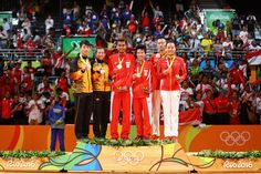 Silver medalists, Peng Soon Chan and Liu Ying Goh of Malaysia, gold medalists, Tontowi Ahmad and Liliyana Natsir of Indonesia and bronze medalists Nan Zhang and Yunlei Zhao of China celebrate on the podium after the Mixed Doubles Gold Medal Match on Day 12 of the Rio 2016 Olympic Games at Riocentro - Pavilion 4 on August 17, 2016 in Rio de Janeiro, Brazil.