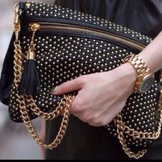 Loving this studded black and gold bag