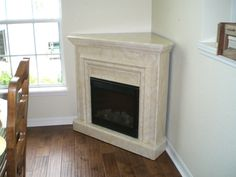 Fabulous contemporary corner electric faux fireplace with modern design als Corner Fireplace Mantels, Build A Fireplace, Fireplace Logs, Fireplace Inserts, Modern Fireplace, Fireplace Design, Fireplace Ideas, Fireplace Decorations, Mantel Ideas
