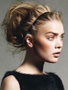 Curl your hair with a big curling iron to give it some body and texture. Tease gently from roots to ends then tie into a high ponytail making sure to not pull too tight at the roots. Finally, add the headband.