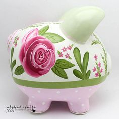 This pink and green floral personalized piggy bank is created with porcelain ceramic and is completely hand painted using the highest quality acrylic paint. The art is forever protected by a glossy diamond finish glaze. Each piggy bank is hand painted especially for you on an individual