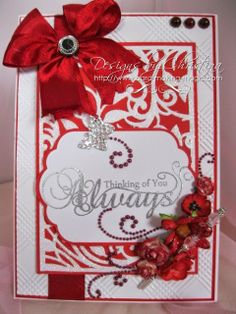elegant red card by Christina Griffiths... includes a stick pin on the card you can remove and wear