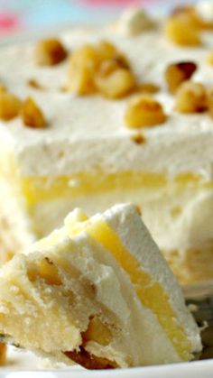 Lemon Lush Recipe ~ A layered dessert with a shortbread crust, sweetened cream cheese, lemon pudding and whipped cream... SO much better than any pie!