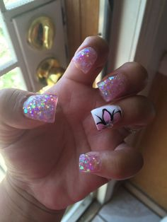 Cute white and pink glitter nail art with a black and pink flower detail.