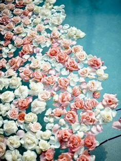 Stunning swimming pool flower decor with roses! Want to do this but I instead with peonies or dahlias! bigislandreale.com thinks this would be another lovely way to decorate your Hawaiian poolside wedding.