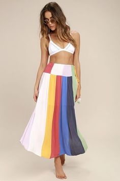 Everything will stop when you float into the room in the Put on a Show Lavender Striped Midi Skirt! Gauzy woven fabric with a colorful lavender, white, coral red, golden yellow, and blue striped print flows from a high, smocked waist. Flaring midi silhouette and tying waist with tasseled ends.