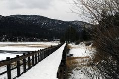 Snowy bridge over icy water. Big Bear, California