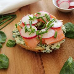 Veggie and Herb Cream Cheese on Everything Bagel, Topped with Smoked Salmon, Radish, and Chives