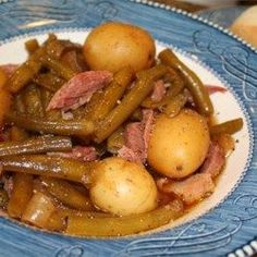Slow Cooker Green Beans, Ham and Potatoes Recipe and Video - Fresh green beans slow cooked until tender with ham hocks, new potatoes and light seasoning.