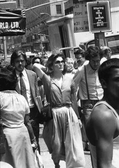 Jackie blending in with the crowd walking in New York City on July 20, 1978.