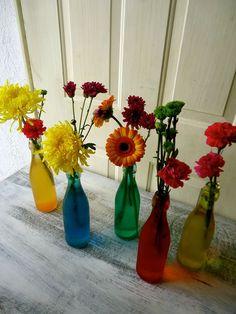 CBC240 Weddings Riviera Maya different colored bottles with a colourful floral mix / Bodas botellas con flores de diferentes colores
