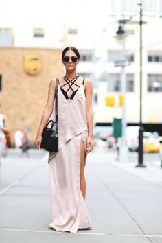 Yoita wears Sabo Luxe dress, Sass and Bide bra, Givenchy bag, Adidas trainers.