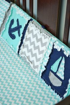 Baby Crib Bedding with applique whales, anchors, and sailboats. Comes in a beautiful combination of gray, Navy, and aqua fabrics. Many different pieces available include: - Small Crib Quilt - Standard
