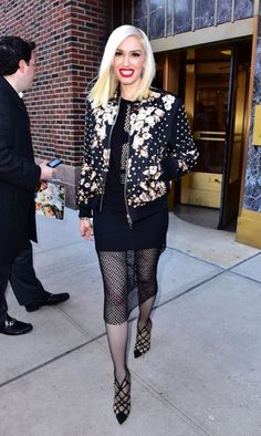 Gwen Stefani in a fishnet dress and bomber jacket in New York City.