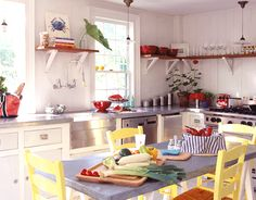 coastal kitchen with yellow chairs